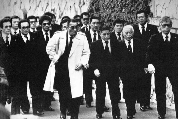 Top members of the Yamaguchi-gumi arrive in Kobe in 1988 for the funeral for their boss, Masahisa Takenaka, who was killed by a splinter group's gunman. Photo: Associated Press