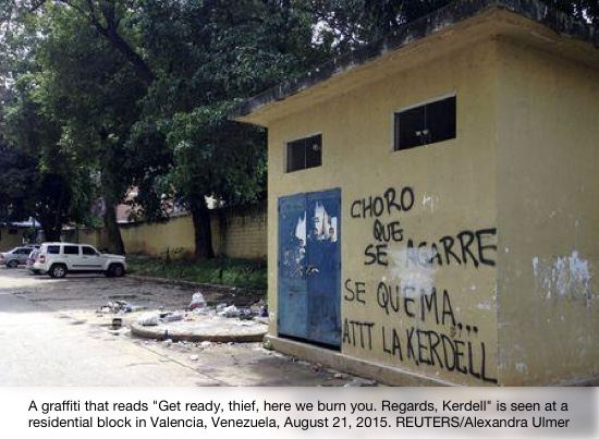 "A graffiti that reads ""Get ready, thief, here we burn you. Regards, Kerdell"" is seen at a residential block in Valencia"