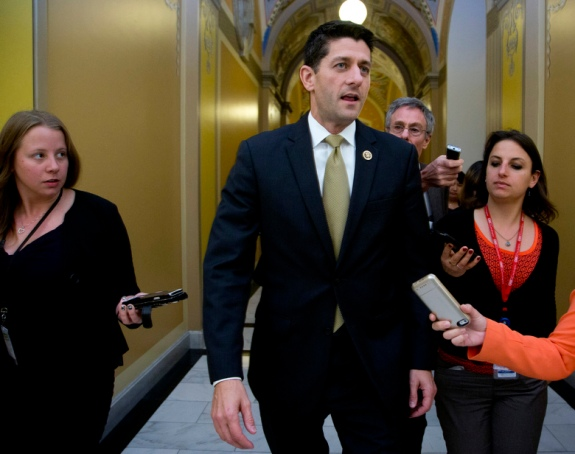 Rep. Paul Ryan, R-Wis., speaks to reporters on Capitol Hill in Washington, Wednesday, Oct. 21, 2015, following meetings with House Republican leaders and the Freedom Caucus members. Ryan seeking unity in a place it's rarely found, is telling House Republicans he will serve as their speaker only if they embrace him by week's end as their consensus candidate. (AP Photo/Manuel Balce Ceneta)