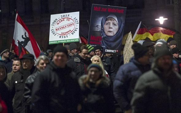 Supporters of Legida, a local copycat of Dresden's Pegida, during a rally in Leipzig