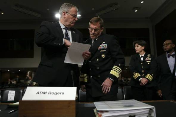 Adm. Michael Rogers, center, director of the National Security Agency and commander of the U.S. Cyber Command, confers with Deputy Defense Secretary Robert Work ahead of testifying before the Senate Armed Services Committee in September.