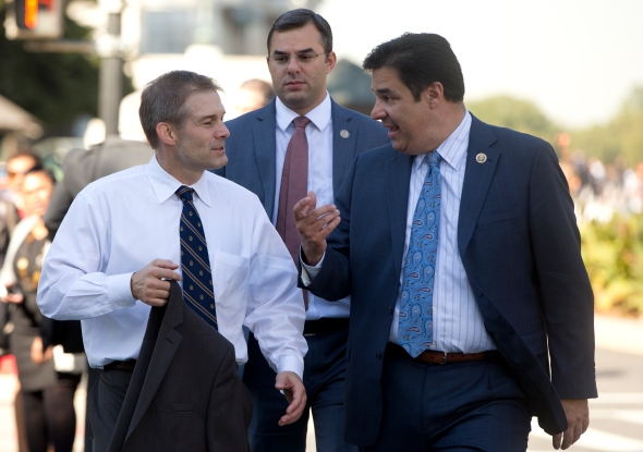 Rep. Jim Jordan, R-Ohio, left, and Freedom Caucus members Rep. Justin Amash, R-Mich., center, and Rep. Raul Labrador, R-Idaho, walk on Wednesday from the U.S. Capitol to the Longworth House Office Building in Washington. (Carolyn Kaster/AP)