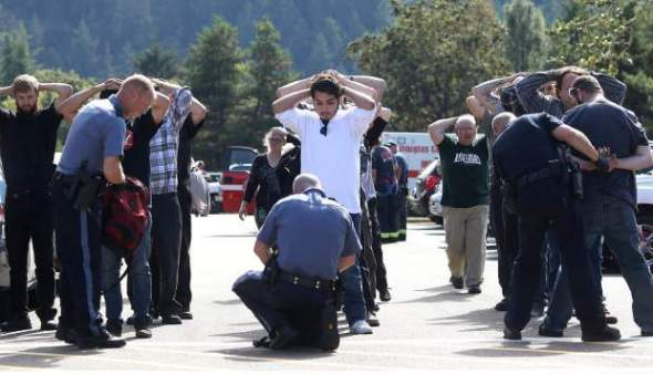 Students at the scene of the UCC shooting. (MICHAEL SULLIVAN/The News-Review)