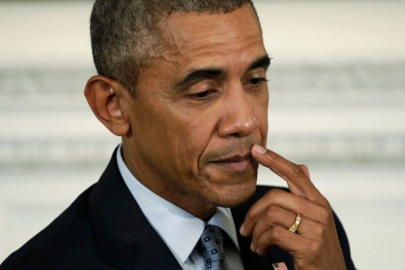 U.S. President Barack Obama pauses during news conference in the State Dining Room at the White House in Washington