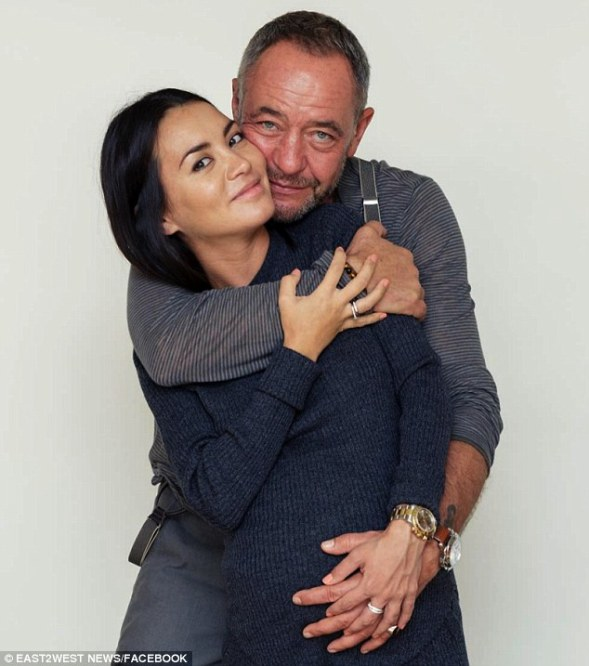 Murdered? Mikhail Lesin and his new love Victoria Rakhimbayeva, who were photographed when she was pregnant. He was found dead last Friday in a Washington DC hotel - and now speculation is mounting about him