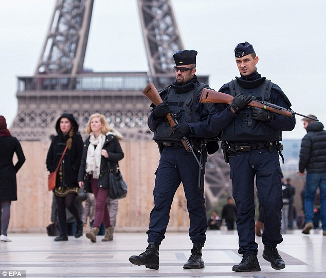Two armed policemen were among the extra officers drafted in to patrol streets near the Eiffel Tower in Paris