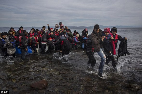 Relief: Drowning at sea is classed as a violent death by the coroners' association, and therefore a post-mortem is mandatory. Pictured, refugees and migrants arriving on Lesbos today