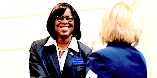 Bobby Ellis/bellis@state-journal.com Lt. Gov. Candidate Jenean Hampton shakes hands with Jenny Goins during the ceremony to celebrate the Class of 2015 Veteran's Hall of Fame inductees.
