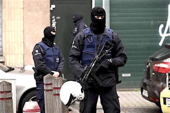 TOPSHOTS Police officers stand guard as an operation takes place in the Molenbeek district of Brussels on November 16, 2015. Belgian police launched a major new operation in the Brussels district of Molenbeek, where several suspects in the Paris attacks had previously lived, AFP journalists said. Armed police stood in front of a police van blocking a street in the run-down area of the capital while Belgian media said officers had surrounded a house. Belgian prosecutors had no immediate comment. AFP PHOTO / JOHN THYSJOHN THYS/AFP/Getty Images