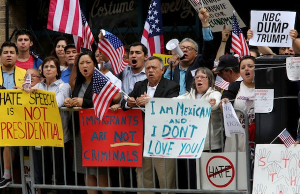 Approximately 100 protesters rally outside the City Club of Chicago before the arrival of 2016 presidential candidate Donald Trump on Monday, June 29, 2015 in Chicago. (Antonio Perez/Chicago Tribune/TNS)