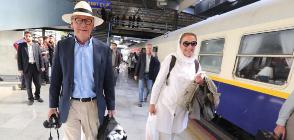 Tourists walk on a platform at a station in Tehran after arriving in the Iranian capital on a luxury train from Budapest on October 27, 2014. The tourists from Germany, Russia, Switzerland, Denmark, Britain, Australia, Spain, Singapore and Turkey spent two weeks visiting Tabriz, Zanjan, Yazd, Isfahan, Shiraz before arriving in Tehran for their flight back to Istanbul, on a trip reportedly costing up to $31,000. AFP PHOTO/ATTA KENARE (Photo credit should read ATTA KENARE/AFP/Getty Images)