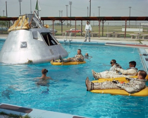 The Apollo 1 crew are pictured here during water egress training. Image Credit: NASA