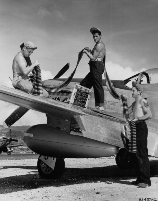 P-51 Mustang fighter being re armed on Saipan (1945)