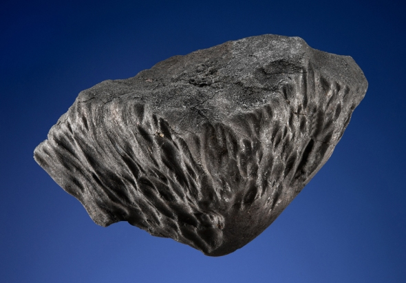 This meteorite was part of the Chelyabinsk meteorite shower of February 15, 2013. Unlike 95% of all other meteorites, this meteorite did not tumble or invert during its descent to Earth. To be sold at Christie's in April 2016. (It measures 4.5 inches across and weighs 2 pounds). Credit: © Mark Mauthner / Christie's