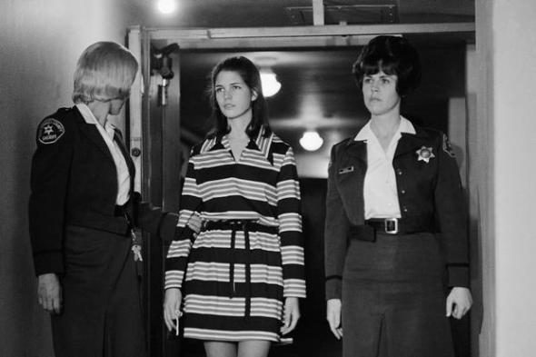 "Leslie Van Houten, 19, a member of Charles Manson's ""family"" who is charged with the murders of Leno and Rosemary LaBianca, is escorted by two deputy sheriffs as she leaves the courtroom in Los Angeles, Dec. 19, 1969 after a brief hearing at which time she was appointed a new attorney. The court appointed Marvin Part to represented Ms. Van Houten after her previous attorney said she and her family could not pay his fees. (AP Photo/George Brich)"