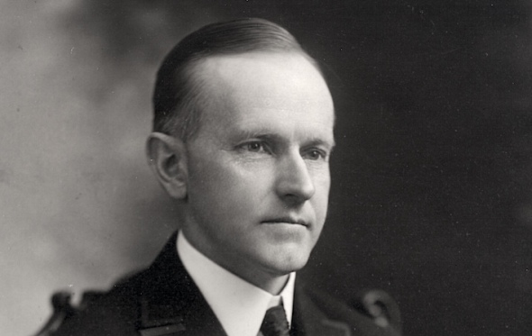 Calvin_Coolidge_bw_head_and_shoulders_photo_portrait_seated_1919