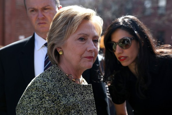 Hillary Clinton and Huma Abedin arrive for a NATO Foreign Minister family photo in front of the Brandenburg Gate in 2011. Photo: Getty Images