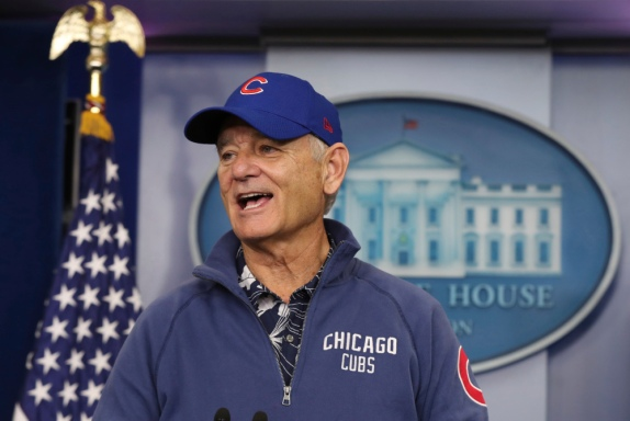 Actor Bill Murray sporting a Chicago Cubs jacket and cap talks during a brief visit in the Brady Press Briefing Room of the White House in Washington, Friday, Oct. 21, 2016. Murray is in Washington to receive the Mark Twain Prize for American Humor. (AP Photo/Manuel Balce Ceneta) ORG XMIT: DCMC206