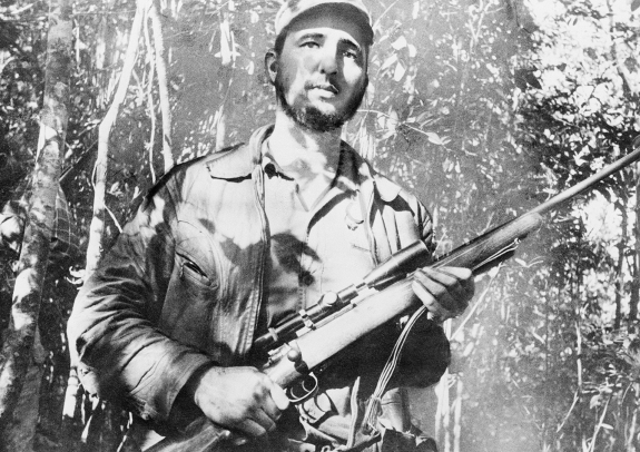 Revolutionary communist leader Fidel Castro, displaying his instrument for enforcing endless possibilities.