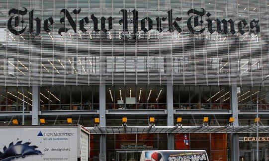 A taxi passes by in front of The New York Times head office in New York