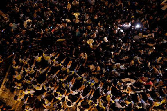 Police face off against protesters in Hong Kong on Sunday, Nov. 6, 2016.