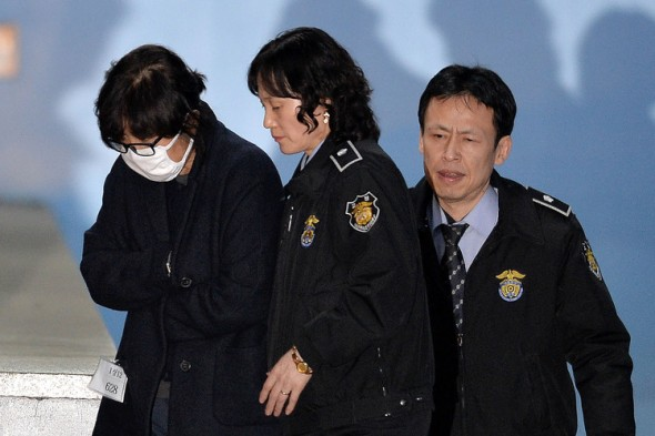 Choi Soon-sil, left, who is at the heart of a political scandal engulfing Ms. Park, was arrested in Seoul this month.