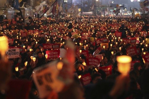 South Korean protesters calling for the resignation of Ms. Park held candles during a rally in Seoul on Nov. 19.