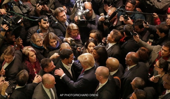 Republican presidential candidate Donald Trump, foreground right center, says goodbye to Dr. Darrell Scott, foreground left center, the senior pastor of New Spirit Revival Ministries in Cleveland Heights, Ohio, in the middle of a media crush in the Trump Tower lobby in New York, Monday, Nov. 30, 2015. Trump met with a coalition of 100 African-American evangelical pastors and religious leaders in a private meeting at Trump Tower. (AP Photo/Richard Drew)