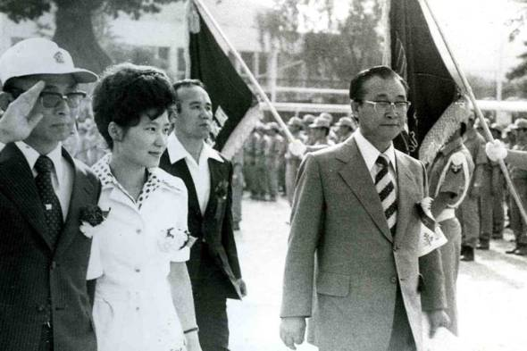 Ms. Park, second from left, in 1975 with Choi Tae-min, right, a religious leader and mystic who claimed to commune with Ms. Park's assassinated mother.