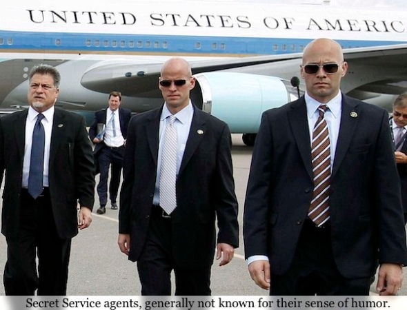 U.S. President Barack Obama walks to greet well-wishers, with Secret Service agents at his side, upon his arrival in Tampa, Florida