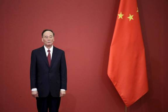 Anticorruption chief Wang Qishan, a powerful ally of President Xi, sits on the seven-member Politburo Standing Committee, China's top leadership body.