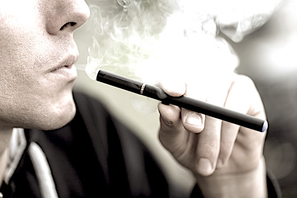 Man smoking e-cigarette