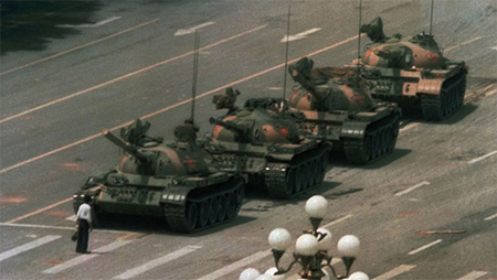 A Chinese man blocks military tanks on Changan Avenue, near Tiananmen Square in Beijing, June 5 1989. (AP Photo / Jeff Widener)