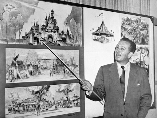 American producer, director, and animator Walt Disney (1901 - 1966) uses a baton to point to sketches of Disneyland, 1955. (Photo by Hulton Archive/Getty Images)