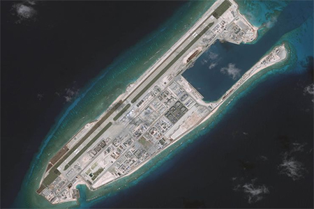 A satellite image of the Fiery Cross Reef located in the South China Sea. Fiery Cross is located in the western part of the Spratly Islands group.