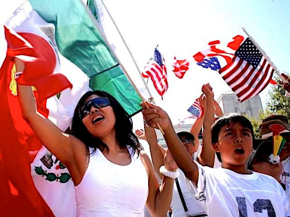 "People march through downtown Los Angeles supporting amnesty for illegal immigrants living in the United States Saturday, Sept. 2, 2006. The event, called ""La Gran Marcha Laboral,"" was organized by the March 25 Coalition, which put on a massive protest in Los Angeles earlier this year. (AP Photo/Oscar Hidalgo)"