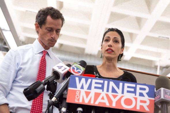 Weiner and Abedin hold a press conference after another scandal surfaces during the 2013 mayoral race. EPA