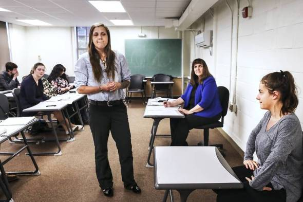 Plymouth State University student Madalyn Stevens, standing, performed in a mock trial in a class led by Prof. Maria Sanders, seated at rear, designed to develop critical-thinking skills. Photo: Cheryl Senter for The Wall Street Journal