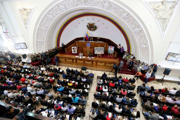 Constitutional Assembly delegate Carmen Melendez speaks from the podium during a session in Caracas, Venezuela, Tuesday, Aug. 8, 2017. The government-backed assembly that is recasting Venezuela's political system filed into the stately domed chamber where congress normally meets. In two previous sessions, the 545-member assembly met in an adjacent, smaller building. (AP Photo/Ariana Cubillos)