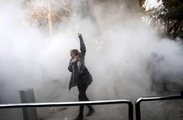 A protester at the University of Tehran, Dec. 30. Photo: STR/EPA-EFE/REX/Shutterstock