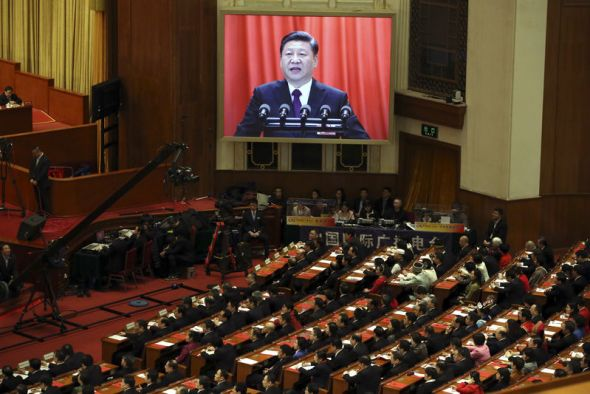 Chinese President Xi Jinping is displayed on a big screen as he delivers a speech at the closing session of the annual National People's Congress in the Great Hall of the People in Beijing on Tuesday.