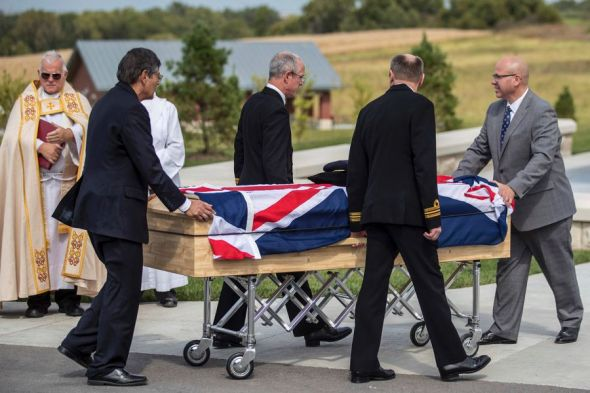 Pallbearers move the casket of Jean Watters for her funeral at the Omaha National Cemetery in Omaha, Neb., on Sept. 24, 2018. Watters was part of the super-secret team that broke the German ENIGMA code during World War II. CHRIS MACHIAN/OMAHA WORLD-HERALD VIA AP