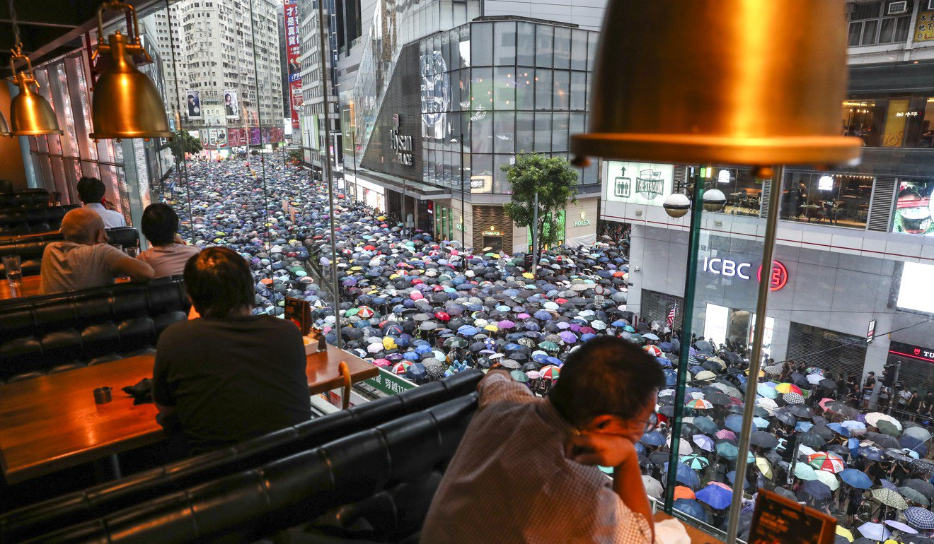 An estimated 1.7 million people took to the streets of Hong Kong on Sunday. Photo: Robert Ng