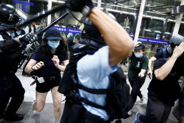 PHOTO: Police clash with protesters at the airport in Hong Kong, Aug. 13, 2019.